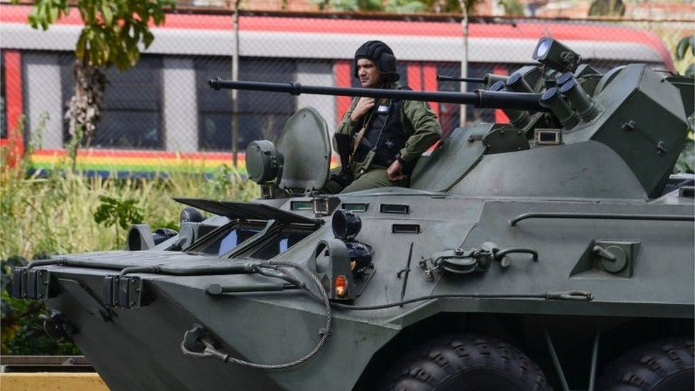 A an armoured tank from the Venezuelan army drives along a highway in Caracas as an operation to capture Oscar Perez
