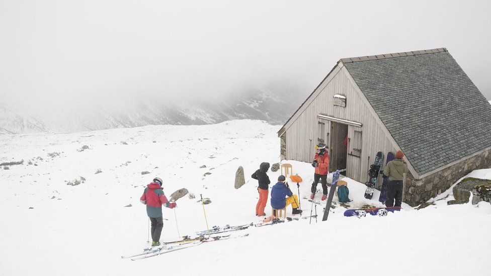 Skiers at the Lake District Ski Club on Raise, next to Helvellyn in the Lake District National Park