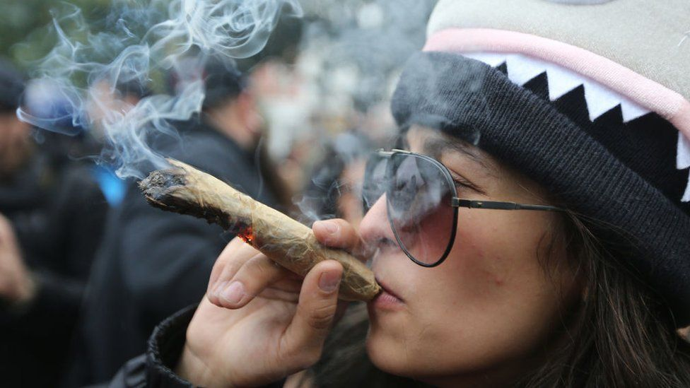 A woman celebrating the legalisation of cannabis in Canada