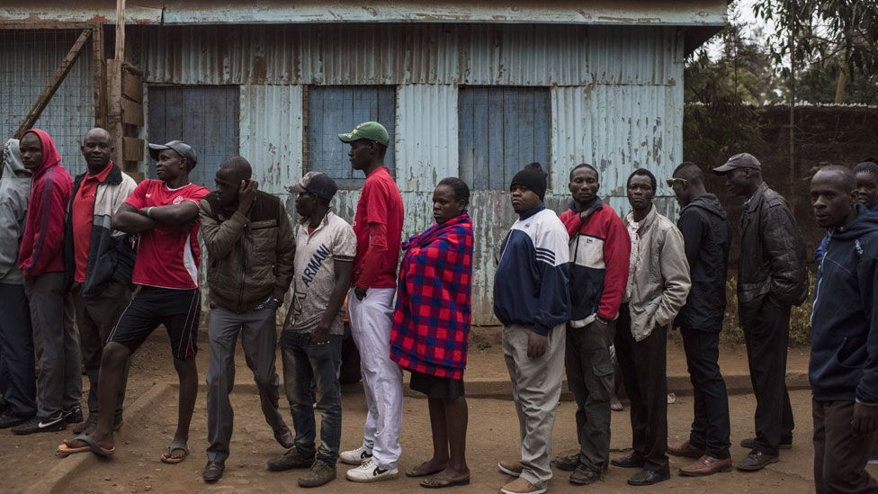 People gather to vote at Olympic Primary School in Kibera, one of the largest slums in Africa, on August 8, 2017 in Nairobi, Kenya. Kenyans head to the polls for a closely contested election between incumbent president Uhuru Kenyatta and his rival Raila Odinga.