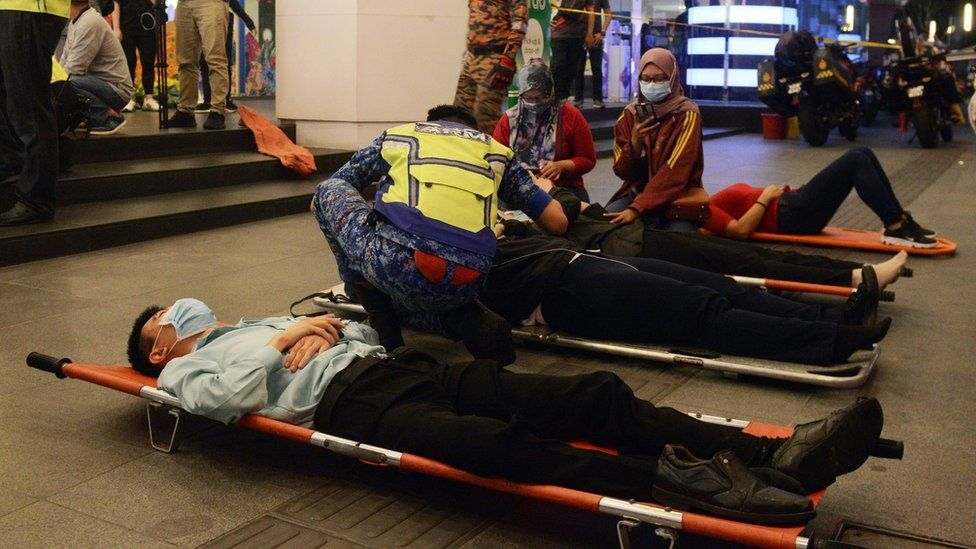 Healthcare workers treating injured passengers in the train station