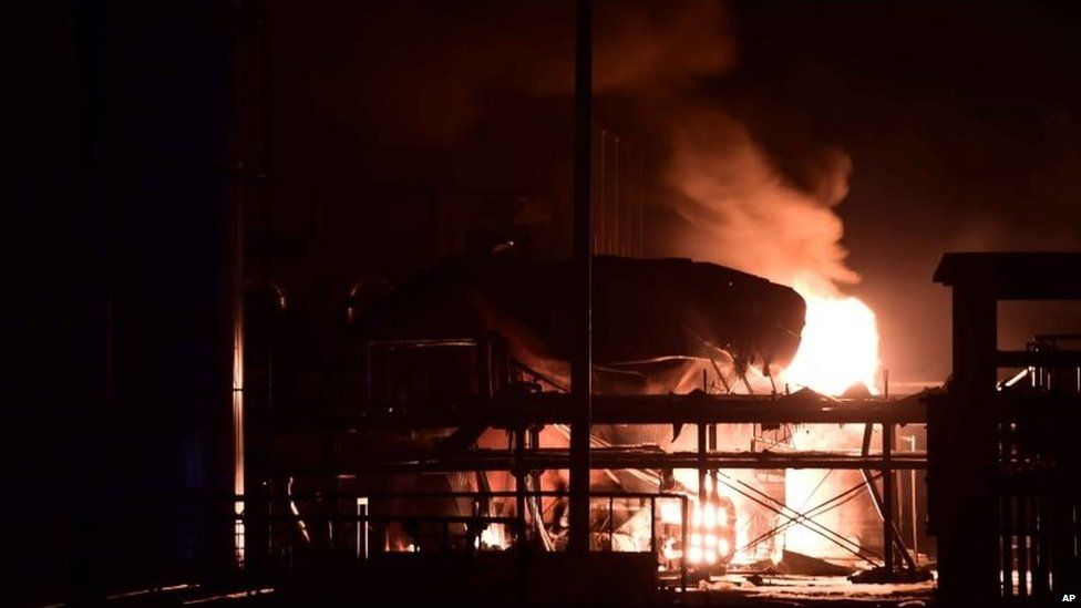 Fire burns at a plant of Shandong Runxing Chemical Technology Co after an explosion in Zibo, Shandong Province 23/08/2015
