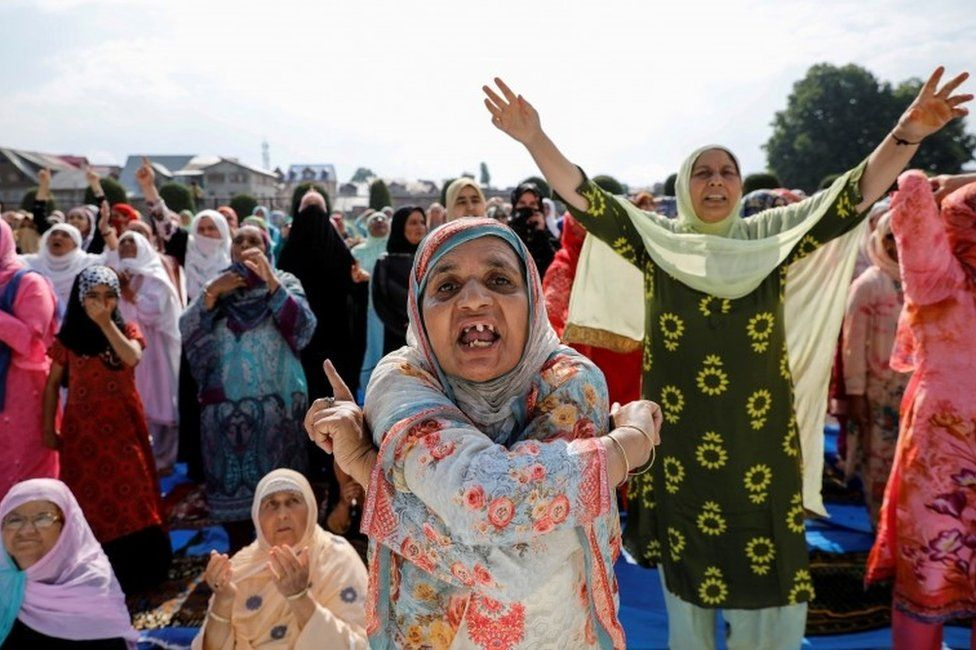 Kashmiri women shout pro-freedom slogans before offering the Eid-al-Adha prayers at a mosque during restrictions after the scrapping of the special constitutional status for Kashmir by the Indian government, in Srinagar, August 12, 2019