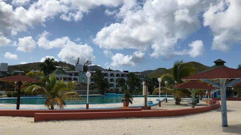 An empty pool at the Starfish Jolly Beach resort