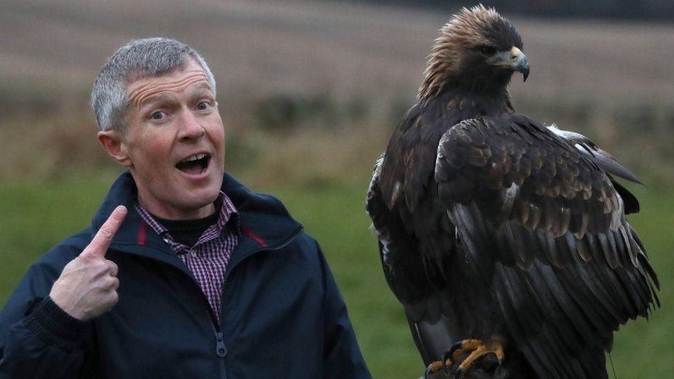 Willie Rennie with a big bird