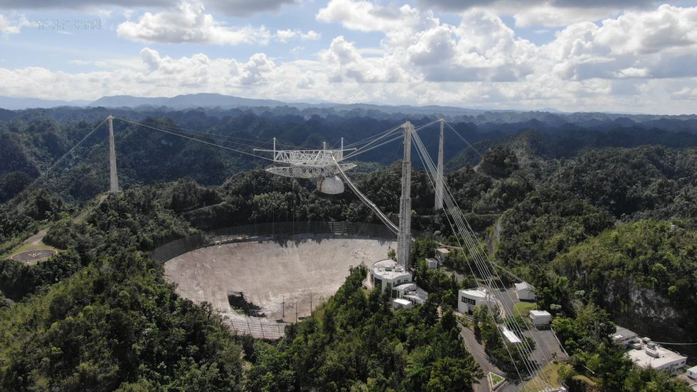 The Arecibo Observatory space telescope, which was damaged in August and in November from broken cables which tore holes in the structure, is seen in Arecibo, Puerto Rico November 7, 2020.