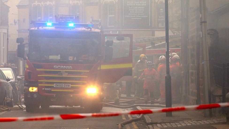 Fire engine in smoke