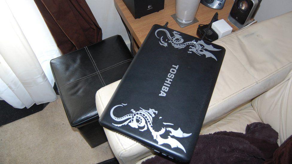 Laptop on armchair