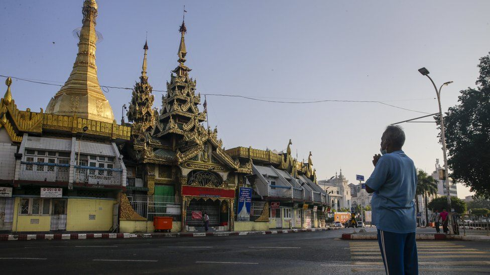 A Myanmar man prays on a platform near Sule Pagoda at downtown area in Yangon, Myanmar, 01 February 2021