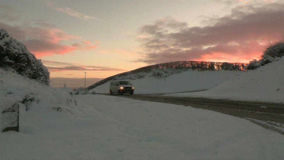 Van on snowy road
