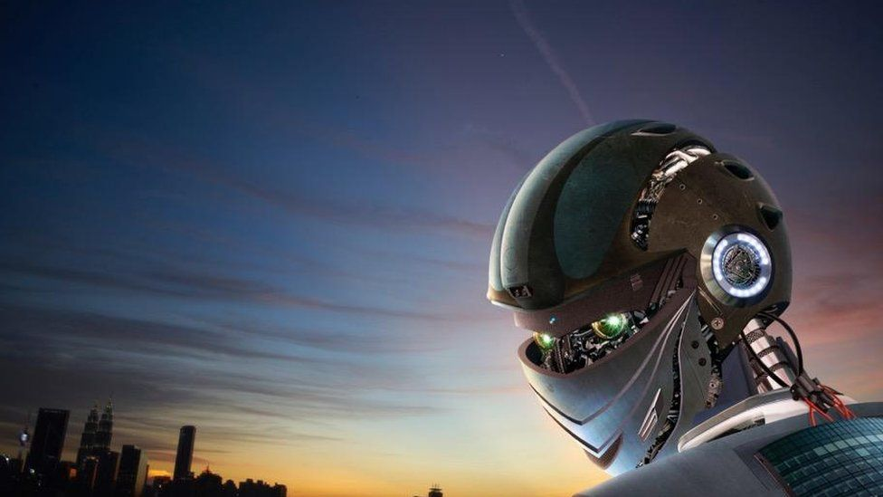 Robot looking at cityscape