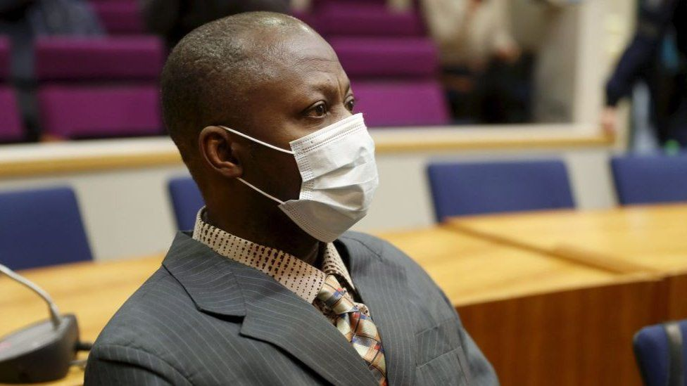 Sierra Leonean national Gibril Massaquoi, wears a face mask as he attends the first day of his trial at the Pirkanmaa District Court in Tampere, Finland