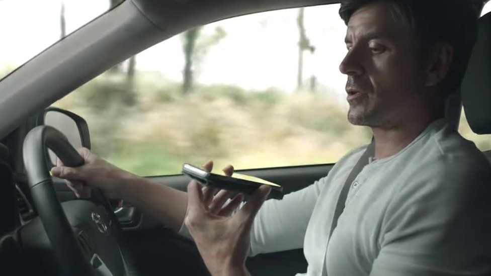 A man using his phone while driving