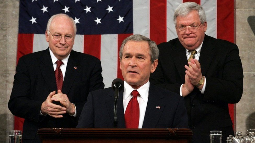 George W Bush, centre, with Dick Cheney, left, and Dennis Hastert