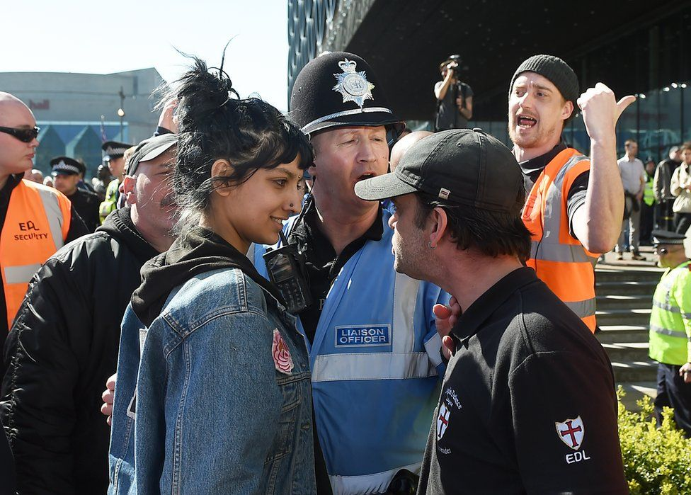 Saffiyah Khan (left) faces down English Defence League (EDL) protester Ian Crossland during a demonstration in the city of Birmingham, in the wake of the Westminster terror attack.
