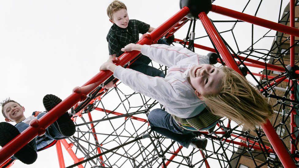 Children playing on a climbing frame
