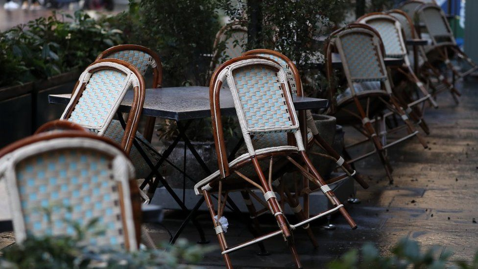 Chairs sit against tables at The Ivy restaurant in Glasgow, Scotland where severe lockdown restrictions are in place