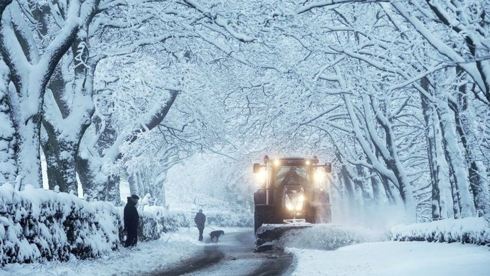 A snowplough clears heavy overnight snow in Carrshield in the Pennines, near Hexham in Northumberland