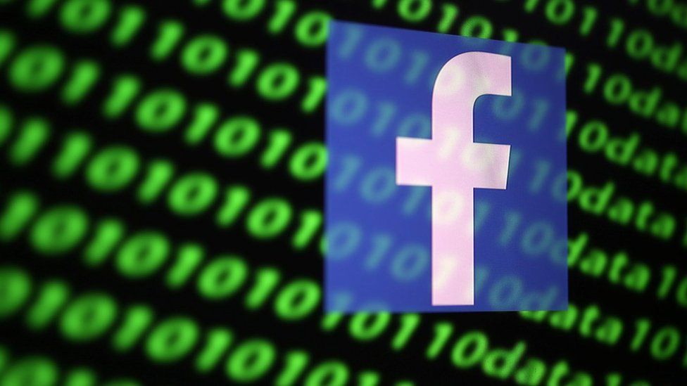 The Facebook logo and binary cyber codes.