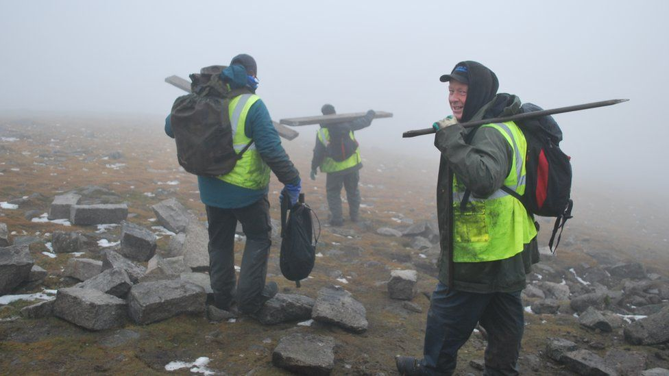 The stonemasons making their way back down Slieve Donard