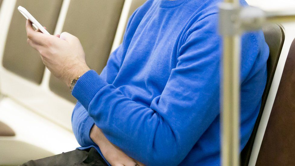 Phone user on public transport