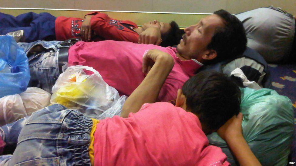Migrants sleep on a ferry from Lesbos to mainland Greece. Photo: 10 September 2015