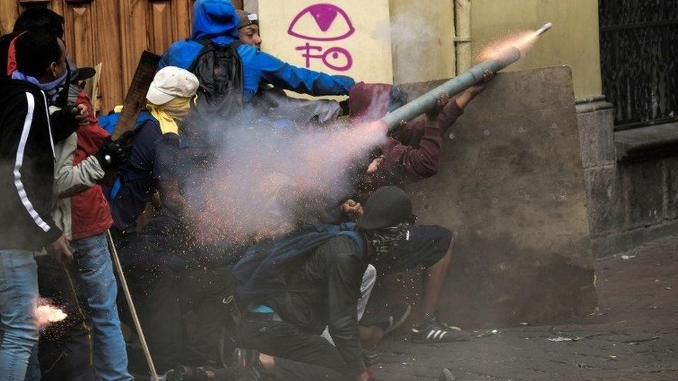 About seven protesters wearing hoods attempting to fire a homemade mortar during the clashes with police