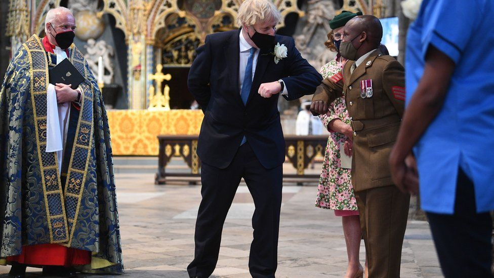 Boris Johnson greets Sgt Sebastian Mwaura from the Defence Medical Group at Westminster Abbey's annual service for the Florence Nightingale Foundation