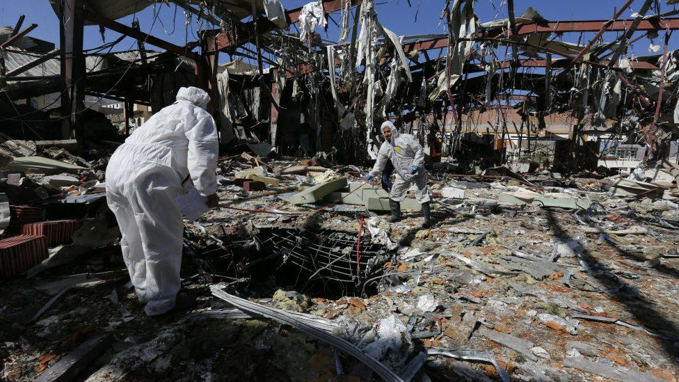 Forensic experts investigate the scene at a community hall, two days after alleged Saudi-led airstrikes hit it, in Sanaa, Yemen, 10 October 2016