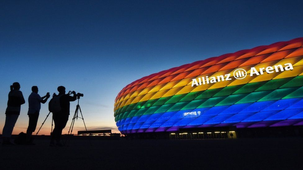 """The facade of the landmark """"Allianz Arena"""" stadium is illuminated in the rainbow colours of the LGBT (Lesbian, Gay, Bisexual and Transgender) movement to mark the Christopher Street Day, in Munich, Germany, 09 July 2016"""
