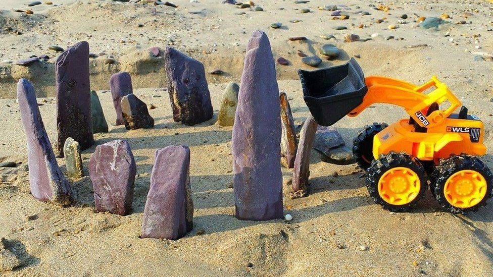 Toy digger and rocks
