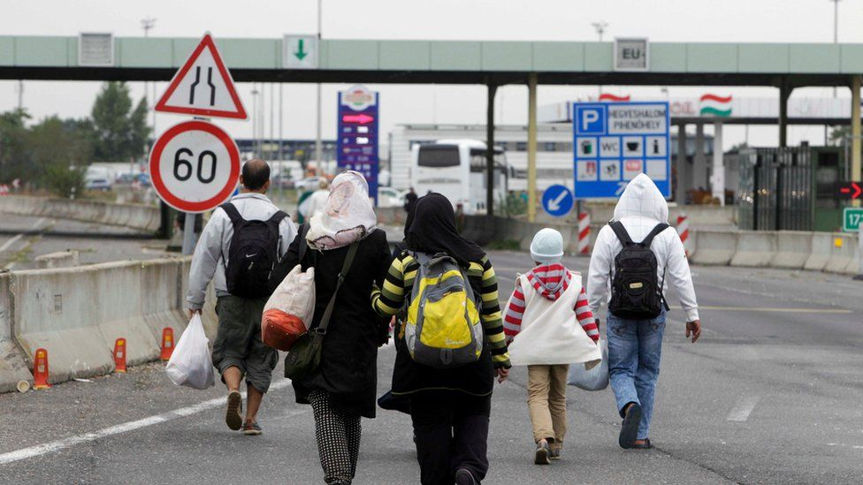 Migrants walk to the Austrian border near the town of Hegyeshalom