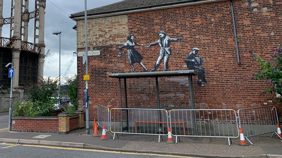 Banksy mural with barriers installed