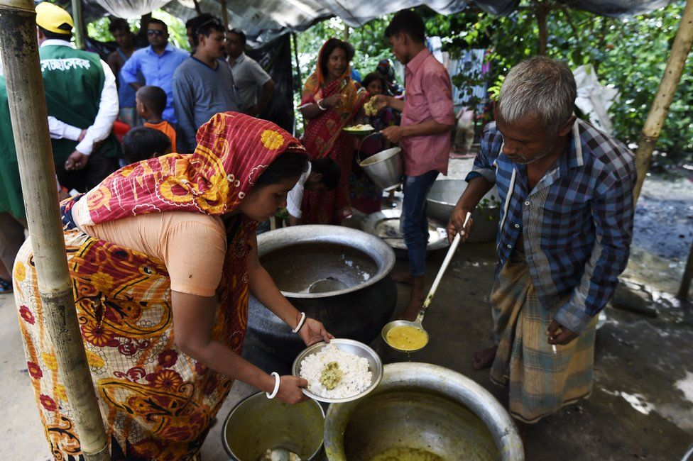 In this photograph taken on 21 September 2017 Hindu refugees from Myanmar cook a meal in a Hindu village near the Bangladeshi town of Kutupalong