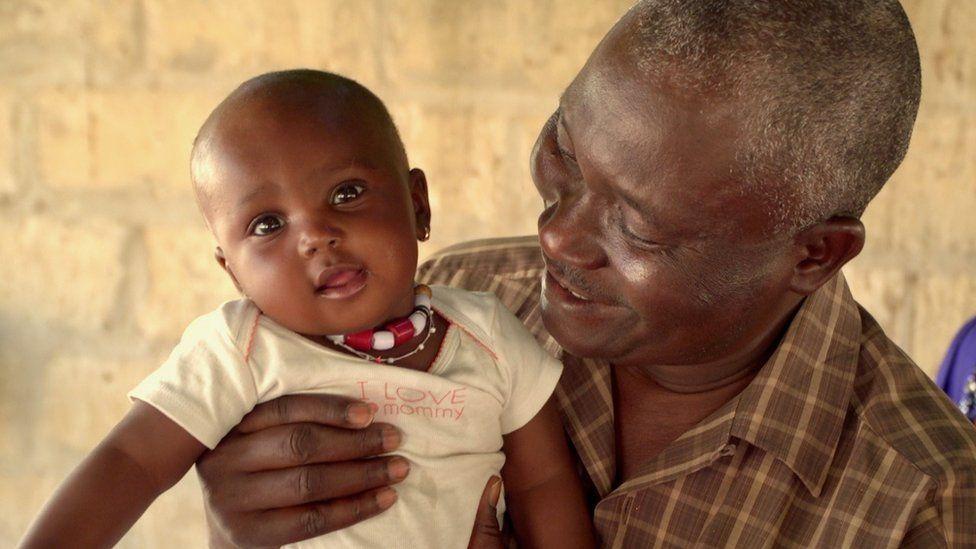 Elhadj Diop and grand-daughter