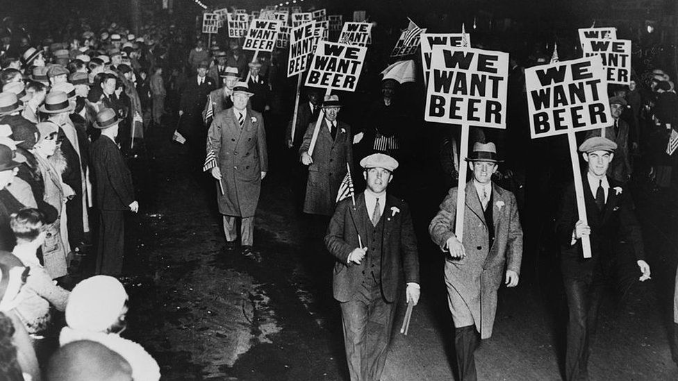 "Men carrying placards reading ""We want beer"" in protests against US prohibition"