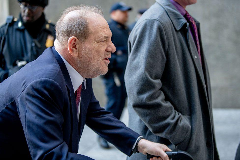 Weinstein arrives in court using a walking frame