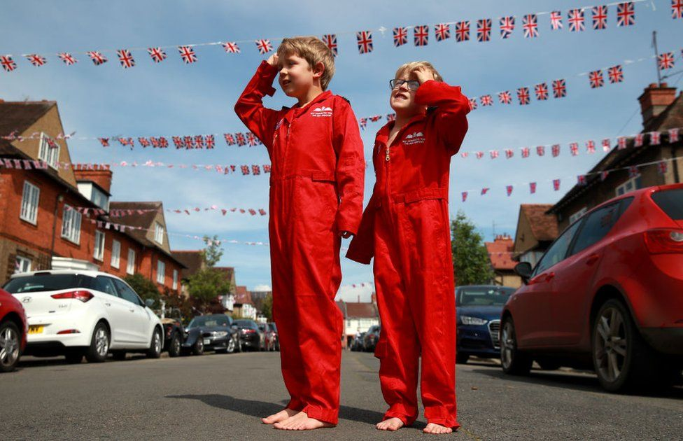 Max Panton, seven, and his five-year-old brother Theo joined the silence wearing their replica RAF Red Arrows uniforms