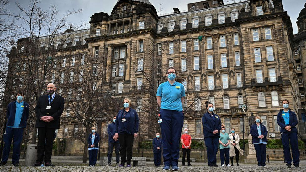 Staff from the Glasgow Royal Infirmary gather outside the hospital for a minute's silence