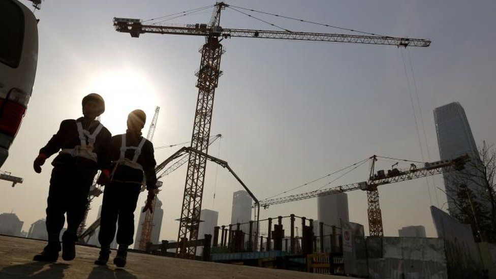 Workers at a construction site in Beijing