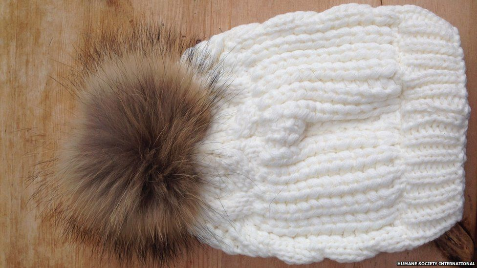 This hat has a fur pom pom