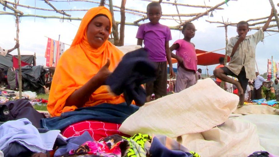 Woman selling clothes in a market