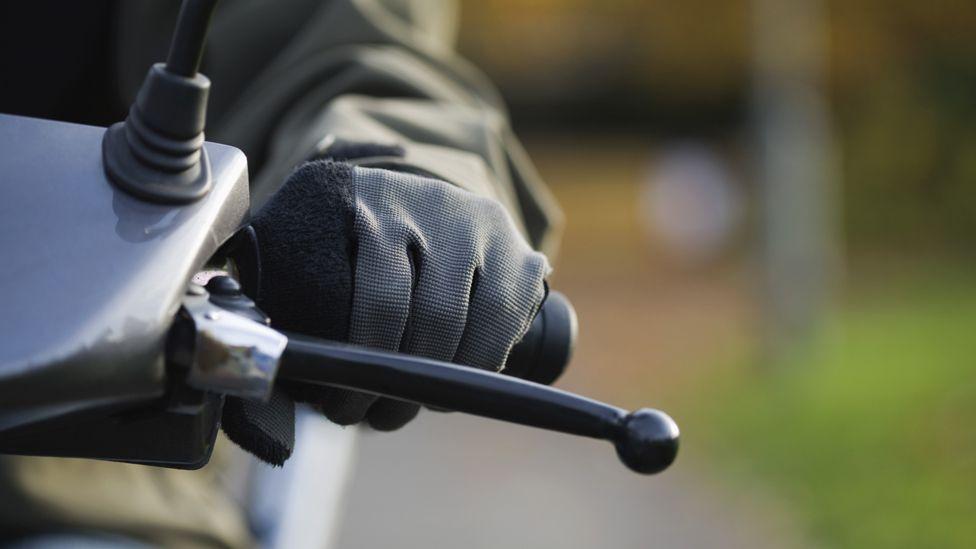 Close up of motorbike handlebars