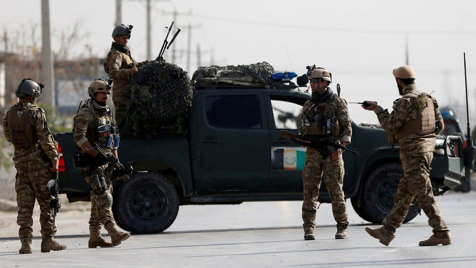 Afghan security forces keep watch at the site of a suicide attack in Kabul, 17 December 2018