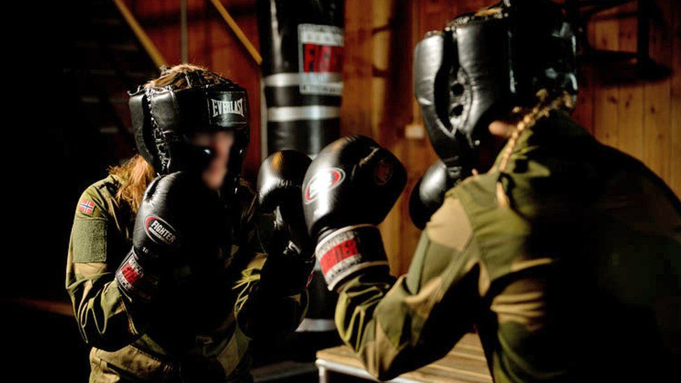 Two soldiers spar
