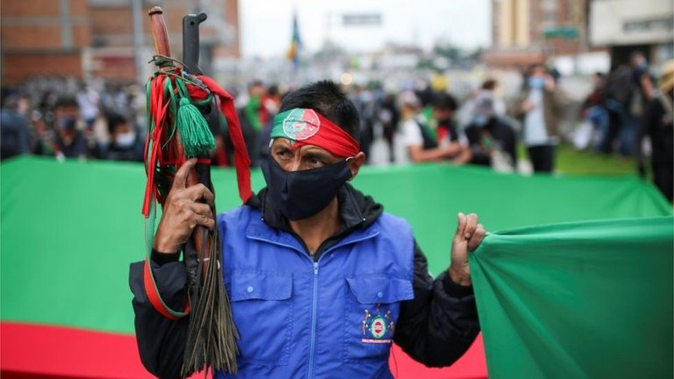 """An indigenous man takes part in a protest against the tax reform of President Ivan Duque""""s government in Bogota, Colombia April 28, 2021."""