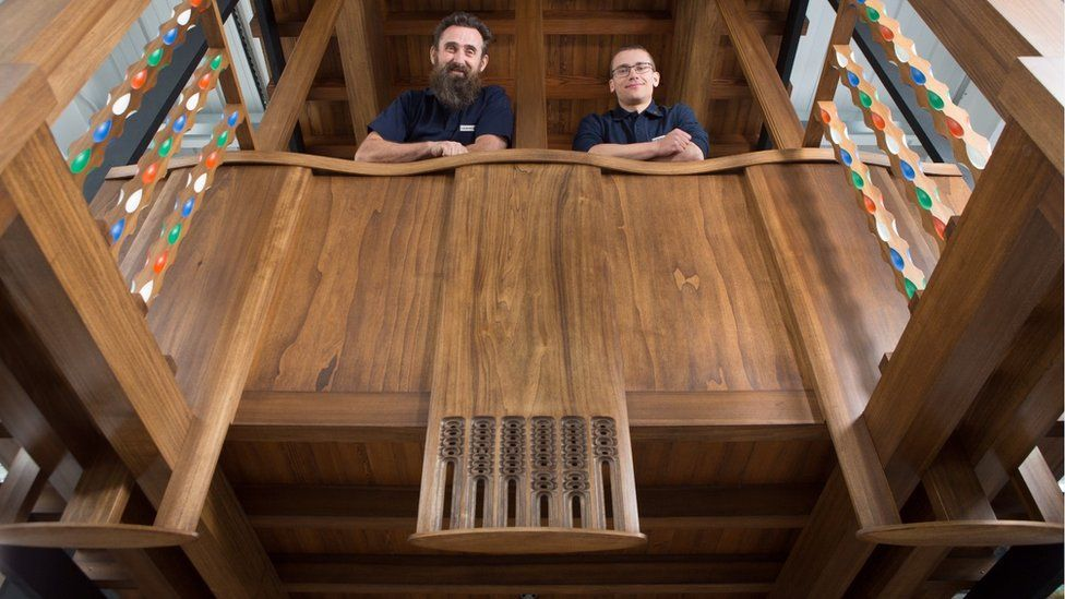 master craftsmen Angus Johnson and Martins Cirulis of Laurence McIntosh in a full-size model of a section of the fire-gutted Mackintosh Library