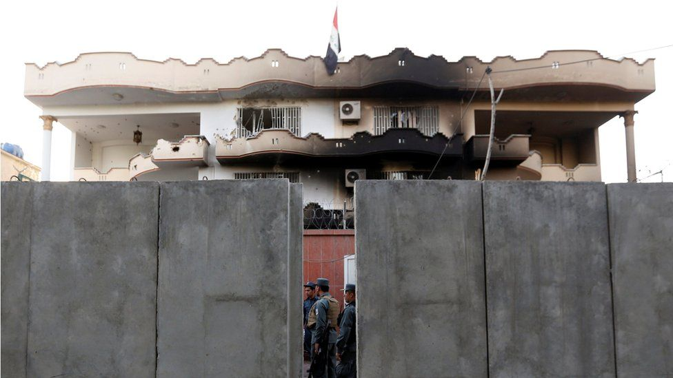 Afghan policemen inspect a building of the Iraqi embassy after an attack in Kabul, Afghanistan July 31, 2017