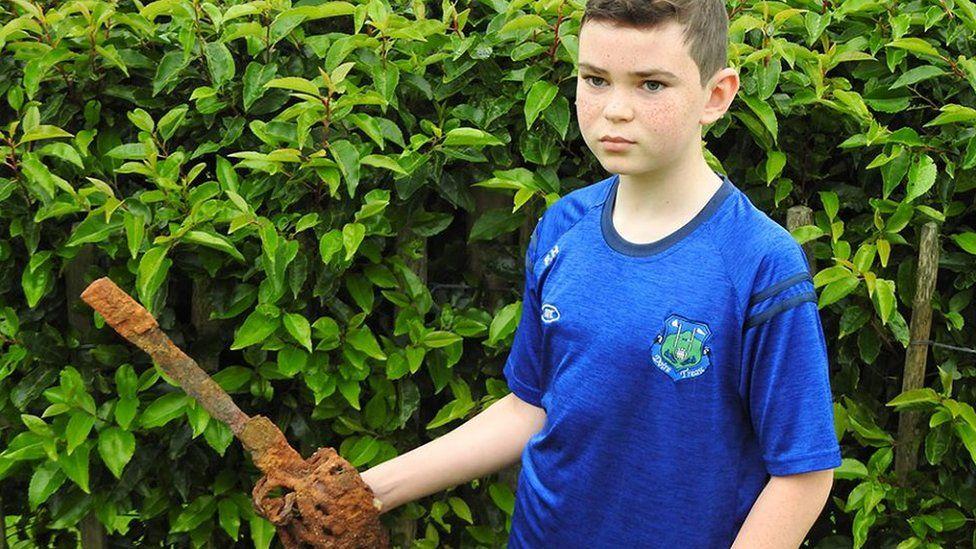 Fionntan Hughes with the sword