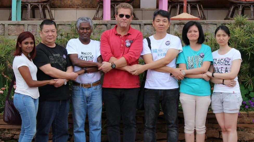 Relatives of some passengers of Malaysia Airlines Flight MH370 hold hands at the Gassy Country House Hotel in Antananarivo, Madagascar, 4 December 2016;
